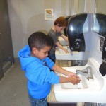 child care safety and health, image of children washing hands