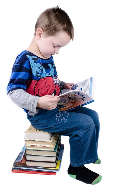 child development. image of young boy reading book